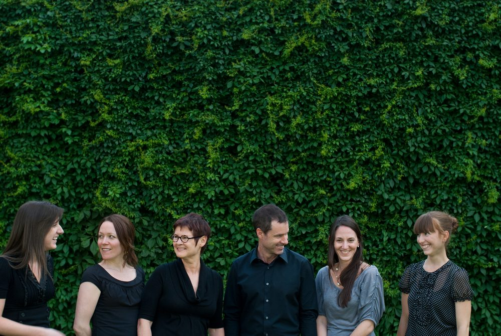 Professional corporate outdoor portrait of work team / Metaphore Design